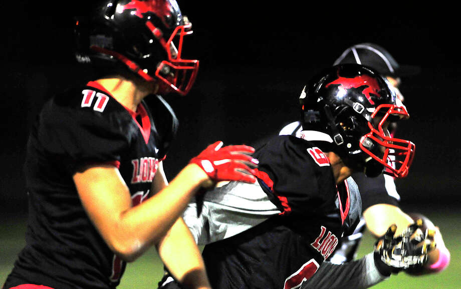 Kountze's Anthony Hafford is congratulated by Jeremiah Baker after running in the first touchdown against Woodville during Friday's game at Kountze. Photo taken Friday, October 21, 2016 Kim Brent/The Enterprise Photo: Kim Brent / Beaumont Enterprise