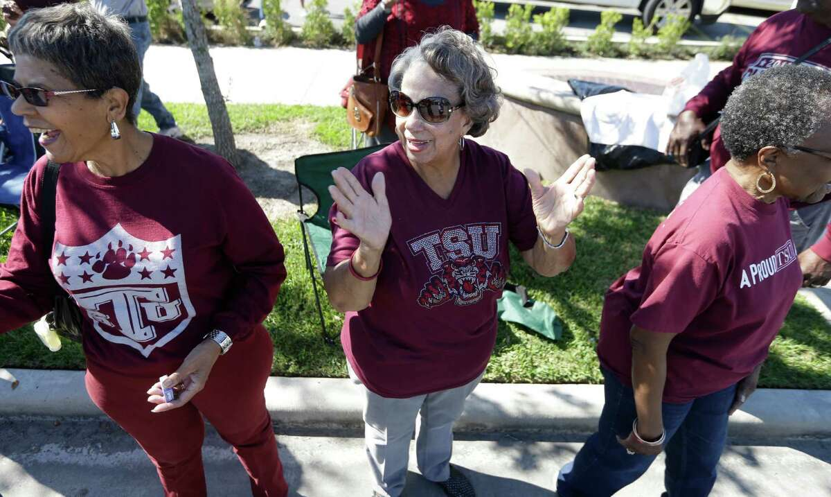 Alma Henley, center, a member of Texas Southern University class of 1961, watches the TSU homecoming parade Saturday, Oct. 22, 2016, in Houston.