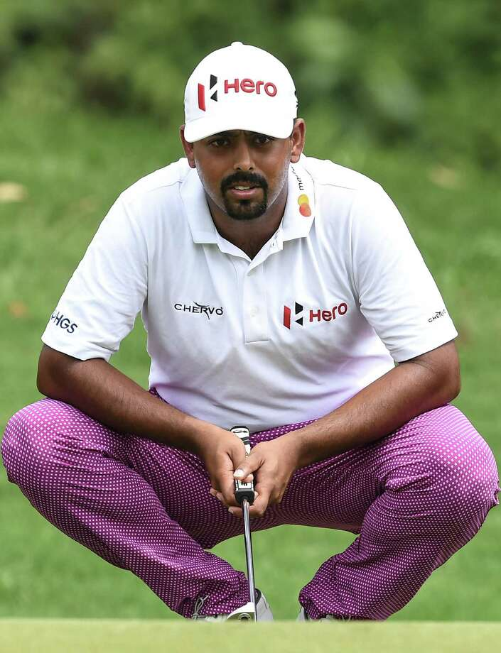 Anirban Lahiri of India lines up a putt during the second round of 2016 CIMB Classic golf tournament in Kuala Lumpur on October 21, 2016. / AFP PHOTO / MOHD RASFANMOHD RASFAN/AFP/Getty Images Photo: MOHD RASFAN / AFP or licensors