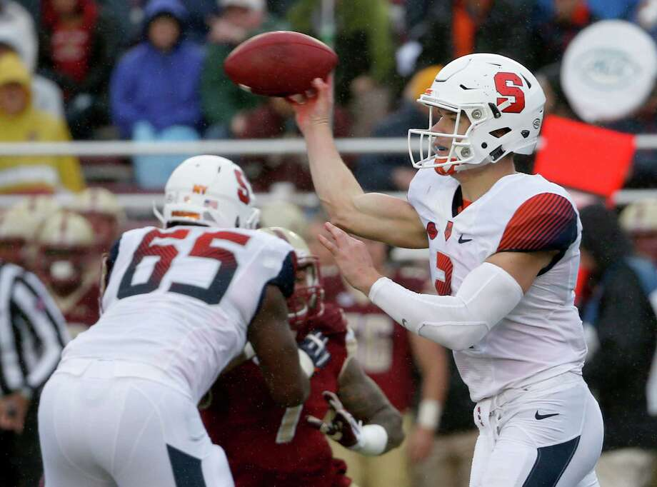 Syracuse quarterback Eric Dungey (2) passes as he gets a block from offensive lineman Jamar McGloster (65) during the first half of an NCAA college football game against Boston College, Saturday, Oct. 22, 2016, in Boston. (AP Photo/Mary Schwalm) ORG XMIT: MAMS109 Photo: Mary Schwalm / FR158029 AP