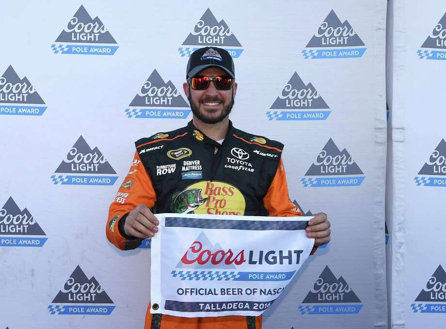 Martin Truex Jr. celebrates pole position for Sunday's NASCAR Sprint Cup auto race at Talladega Superspeedway on Saturday, Oct. 22, 2016, in Talladega, Ala. (AP Photo/Rainier Ehrhardt) ORG XMIT: ALRE114 Photo: Rainier Ehrhardt / Associated Press