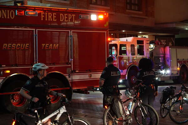 San Antonio firefighters ventilate smoke after a cooking stove caught fire Saturday night, Oct. 22, 2016, at the Sheraton Gunter Hotel, 205 E. Houston St. The fire forced the evacuation of the first two floors.