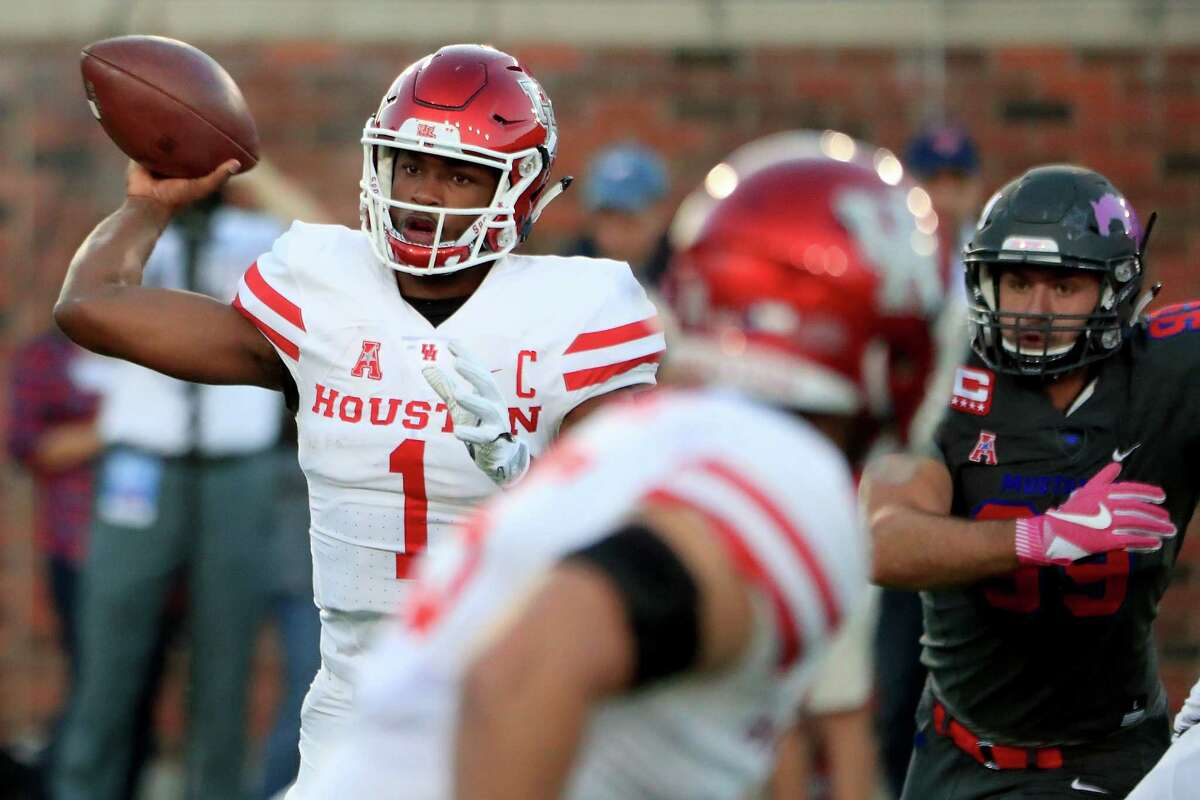 DALLAS, TX - OCTOBER 22: Greg Ward Jr. #1 of the Houston Cougars looks for an open receiver against the Southern Methodist Mustangs in the second quarter at Gerald J. Ford Stadium on October 22, 2016 in Dallas, Texas.