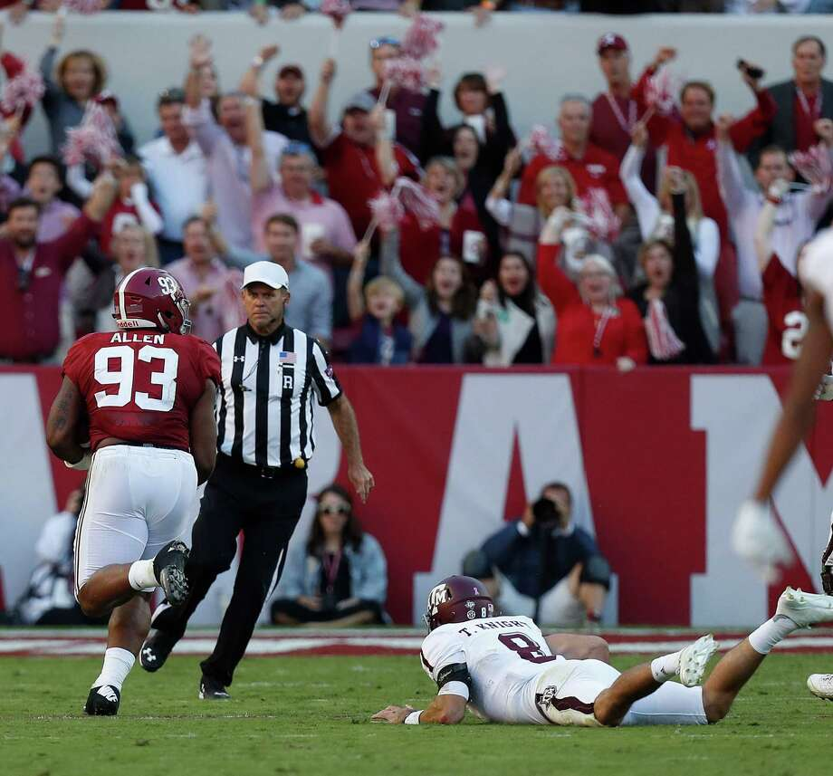 Texas A&M quarterback Trevor Knight can only watch as Alabama defensive end Jonathan Allen returns a fumble recovery for a touchdown in the third quarter Saturday. Photo: Karen Warren, Staff Photographer / 2016 Houston Chronicle