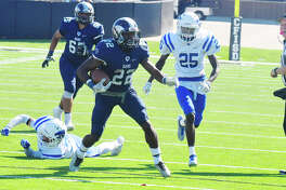Cy Ridge senior rusher Trelon Smith carries for a first down against Cy Creek Saturday at Pridgeon Stadium. Smith was his usual, dynamic self against the Cougars, racking up 213 yards and two touchdowns on 27 carries and catching two passes for 28 yards.