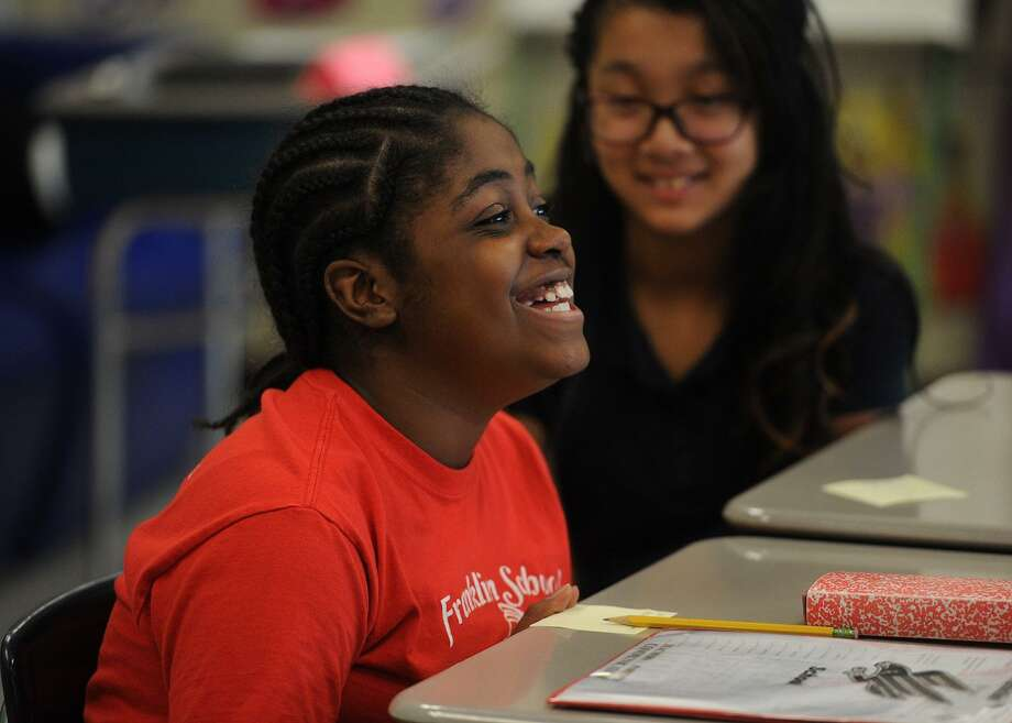 Michele Swaby, 10, is enthusiastic as she comments on the upcoming presidential election in Samantha Rosenberg's 6th grade class at Franklin School in Stratford, Conn. on Thursday, October 19, 2016. Photo: Brian A. Pounds / Hearst Connecticut Media / Connecticut Post