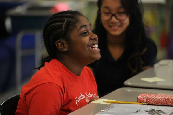 Michele Swaby, 10, is enthusiastic as she comments on the upcoming presidential election in Samantha Rosenberg's 6th grade class at Franklin School in Stratford, Conn. on Thursday, October 19, 2016.