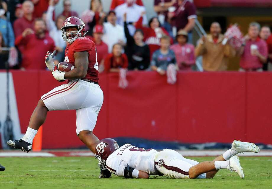 TUSCALOOSA, AL - OCTOBER 22:  Jonathan Allen #93 of the Alabama Crimson Tide returns a fumble for a touchdown as he steps over Trevor Knight #8 of the Texas A&M Aggies at Bryant-Denny Stadium on October 22, 2016 in Tuscaloosa, Alabama.  (Photo by Kevin C. Cox/Getty Images) ORG XMIT: 669366895 Photo: Kevin C. Cox / 2016 Getty Images