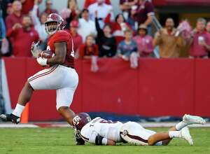 TUSCALOOSA, AL - OCTOBER 22:  Jonathan Allen #93 of the Alabama Crimson Tide returns a fumble for a touchdown as he steps over Trevor Knight #8 of the Texas A&M Aggies at Bryant-Denny Stadium on October 22, 2016 in Tuscaloosa, Alabama.  (Photo by Kevin C. Cox/Getty Images) ORG XMIT: 669366895