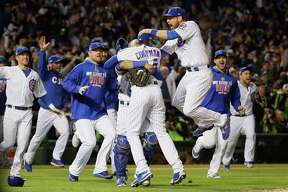 CHICAGO, IL - OCTOBER 22:  The Chicago Cubs celebrate defeating the Los Angeles Dodgers 5-0 in game six of the National League Championship Series to advance to the World Series against the Cleveland Indians at Wrigley Field on October 22, 2016 in Chicago, Illinois.  (Photo by Jamie Squire/Getty Images) ORG XMIT: 676240003