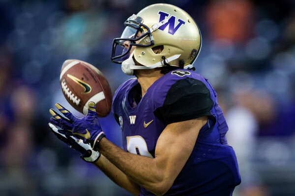 Washington wide receiver Dante Pettis makes a reception in the second half of an NCAA football game against Oregon State at Husky Stadium on Saturday, Oct. 22, 2016.