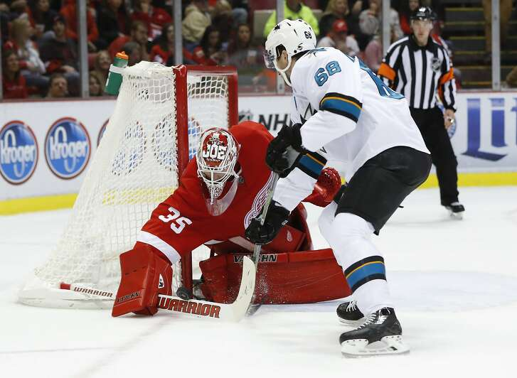Detroit Red Wings goalie Jimmy Howard (35) stops a San Jose Sharks center Melker Karlsson (68) shot in the second period of an NHL hockey game in Detroit, Saturday, Oct. 22, 2016. (AP Photo/Paul Sancya)