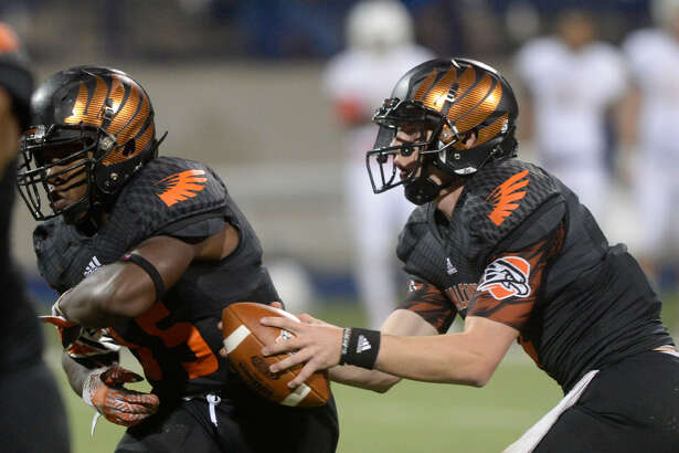 UTPB quarterback Kameron Mathis fake the handoff to running back Marquis Simmons (35) during the game Oklahoma Panhandle State on Saturday, Oct. 22, 2016, at Grande Communications Stadium.