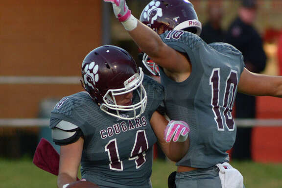 Kempner senior wide receiver Jacob Landry (14) celebrates with teammate and fellow senior wide receiver Matthew Martinez (10) after Landry's second quarter touchdown against Dulles during their District 20-6A matchup at Mercer Stadium on Saturday, Oct. 22, 2016. (Photo by Jerry Baker/Freelance)