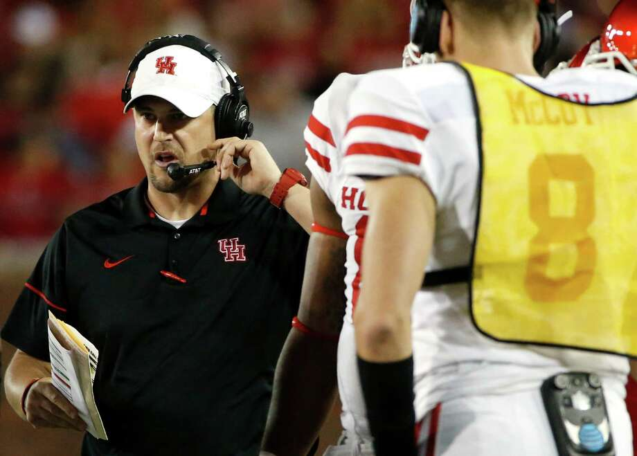 Houston coach Tom Herman works with his team during a timeout in the first half against SMU in an NCAA college football game, Saturday, Oct. 22, 2016, in Dallas. SMU won 38-16. (AP Photo/Ron Jenkins) Photo: Ron Jenkins, Associated Press / FR171331 AP