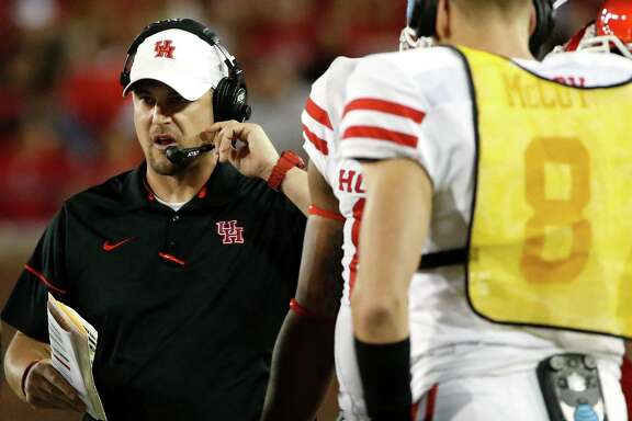 Houston coach Tom Herman works with his team during a timeout in the first half against SMU in an NCAA college football game, Saturday, Oct. 22, 2016, in Dallas. SMU won 38-16. (AP Photo/Ron Jenkins)