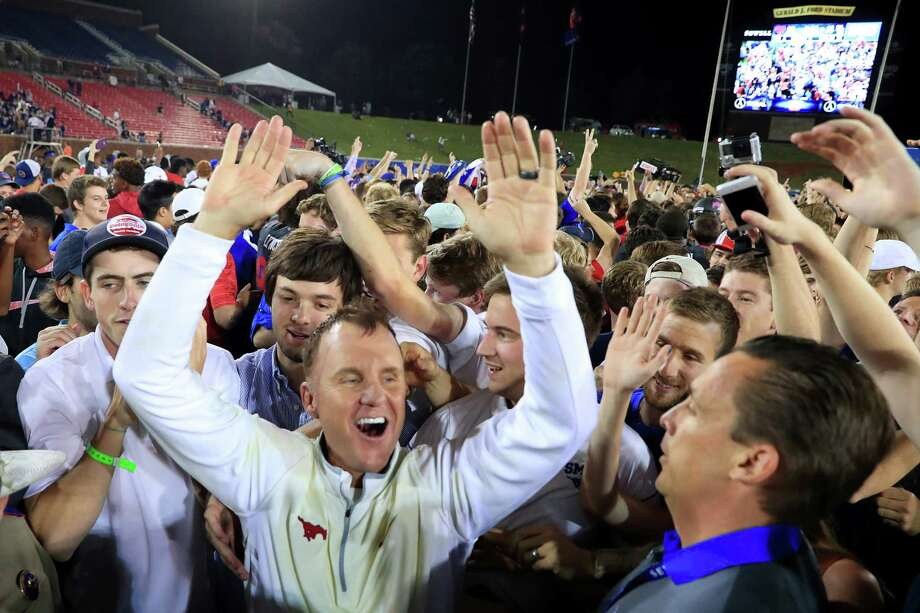 DALLAS, TX - OCTOBER 22:  Head coach Chad Morris of the Southern Methodist Mustangs celebrates with fans after the Southern Methodist Mustangs beat the Houston Cougars 38-16 at Gerald J. Ford Stadium on October 22, 2016 in Dallas, Texas. Photo: Tom Pennington, Getty Images / 2016 Getty Images