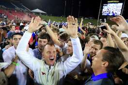 DALLAS, TX - OCTOBER 22:  Head coach Chad Morris of the Southern Methodist Mustangs celebrates with fans after the Southern Methodist Mustangs beat the Houston Cougars 38-16 at Gerald J. Ford Stadium on October 22, 2016 in Dallas, Texas.