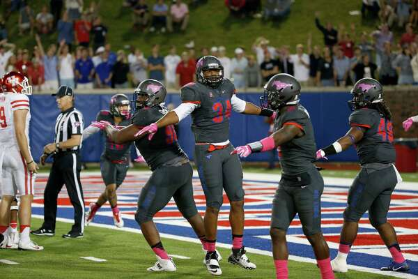 SMU defensive lineman Jarvis Pruitt (34) and teammates celebrate after Houston missed a field goal during the second half of an NCAA college football game, Saturday, Oct. 22, 2016, in Dallas. SMU won 38-16. (AP Photo/Ron Jenkins)