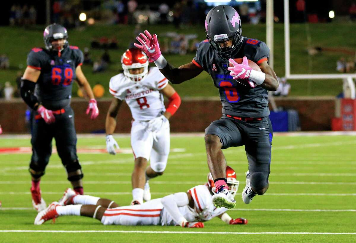SMU running back Braeden West (6) leaps across the goal line to score a touchdown against Houston during the second half of an NCAA college football game, Saturday, Oct. 22, 2016, in Dallas. SMU won 38-16. (AP Photo/Ron Jenkins)