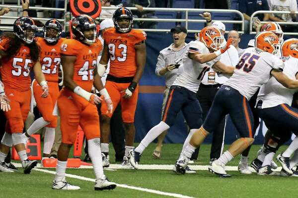 Members of the UTEP Miners celebrate with teammate Warren Redix (far right) after he caught the game-winning pass to defeat the UTSA Roadrunners in five overtimes 52-49 Saturday Oct. 22, 2016 at the Alamodome.