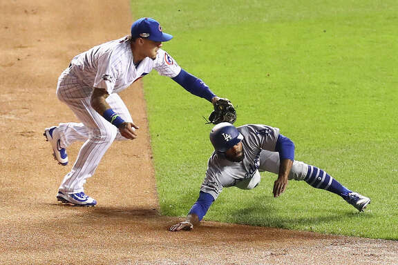 CHICAGO, IL - OCTOBER 22:  Javier Baez #9 of the Chicago Cubs tags out Andrew Toles #60 of the Los Angeles Dodgers at second base in the first inning during game six of the National League Championship Series at Wrigley Field on October 22, 2016 in Chicago, Illinois.  (Photo by Dylan Buell/Getty Images)