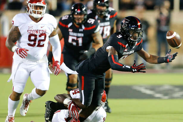 Texas Tech wide receiver Jonathan Giles (9) fumbles the ball after a pass reception against the Oklahoma defense Saturday night. Dr. Wade Clay/Special to the Reporter-Telegram