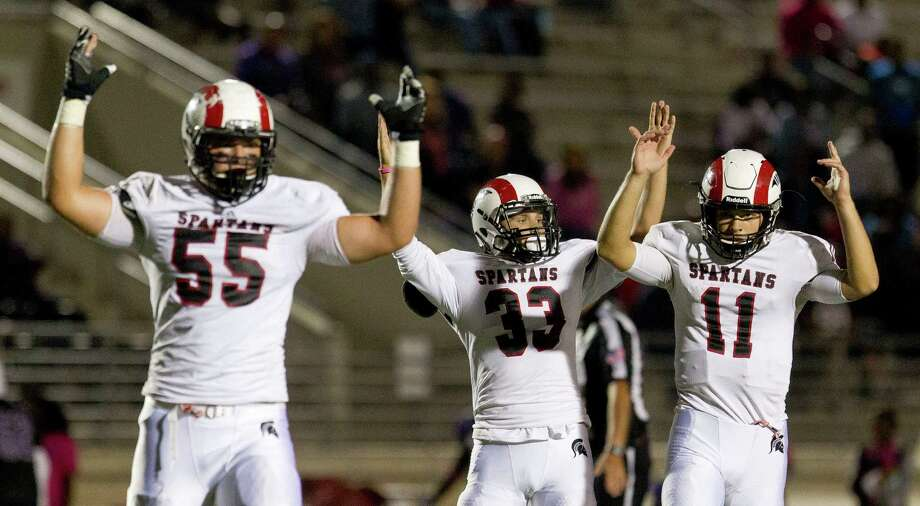 Oct. 22: Porter 35, Humble 6Porter quarterback Jacob Hall (11), offensive linemen Caleb Johnson (55) and running back Cory Cowan (33) raise their hands in celebration after Hall's 19-yard touchdown pass to wide receiver Sevonne Rhea during the fourth quarter of a District 21-5A high school football game at Turner Stadium Saturday, Oct. 22, 2016, in Humble. Photo: Jason Fochtman, Houston Chronicle / Houston Chronicle