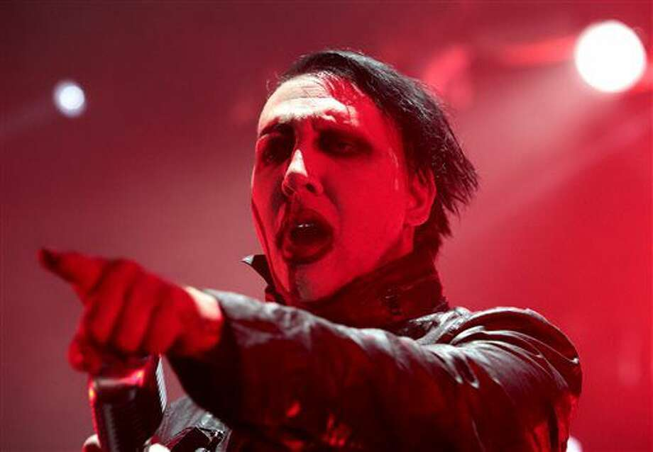 """FILE - In this Aug. 2, 2015 file photo, Marilyn Manson performs in concert during the """"End Times Tour 2015"""" at the Susquehanna Bank Center, in Camden, N.J. Manson isn't supporting either presidential candidate. The shock rock star tells Rolling Stone magazine that he has no intention of voting for either Hillary Clinton or Donald Trump in the 2016 November election. (Photo by Owen Sweeney/Invision/AP, File)"""