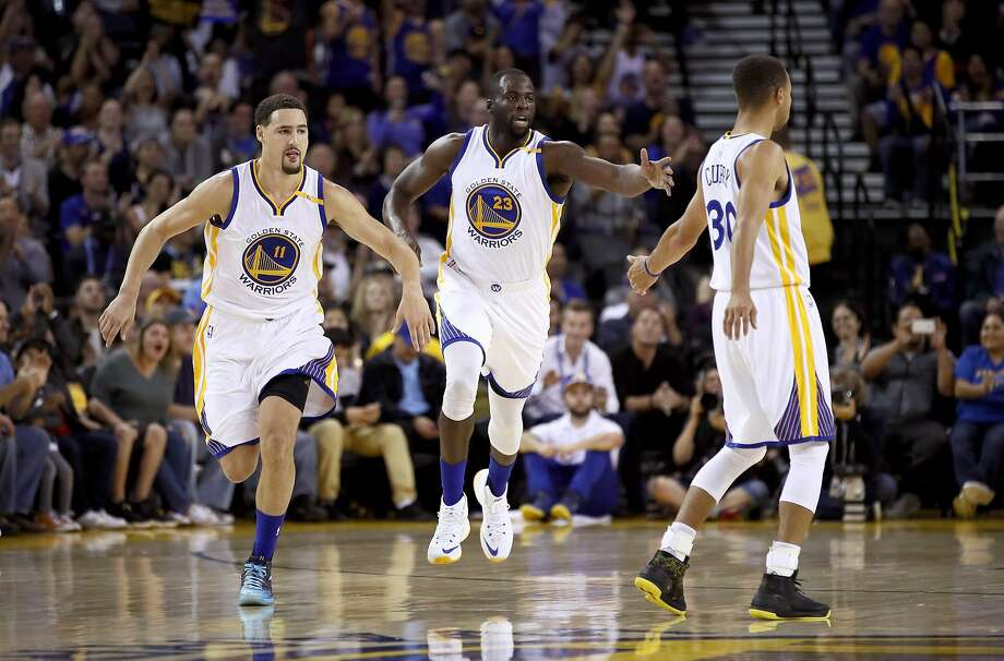 OAKLAND, CA - OCTOBER 04:  Klay Thompson #11 and Stephen Curry #30 congratulate Draymond Green #23 of the Golden State Warriors after he made a basket against the Los Angeles Clippers during their preseason game at ORACLE Arena on October 4, 2016 in Oakland, California.  NOTE TO USER: User expressly acknowledges and agrees that, by downloading and or using this photograph, User is consenting to the terms and conditions of the Getty Images License Agreement.  (Photo by Ezra Shaw/Getty Images) Photo: Ezra Shaw, Getty Images