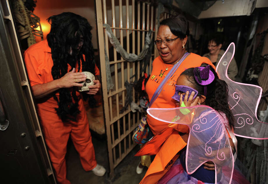 Guests at the Beaumont Police Department's Trunk or Treat event were spooked in the haunted jail that was complete with zombie inmates and scary surprises on Thursday night. Officers also showcased crime-fighting equipment and handed out candy. Photo taken Wednesday, October 31, 2012 Guiseppe Barranco/The Enterprise Photo: Guiseppe Barranco, STAFF PHOTOGRAPHER / The Beaumont Enterprise