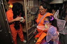 Guests at the Beaumont Police Department's Trunk or Treat event were spooked in the haunted jail that was complete with zombie inmates and scary surprises on Thursday night. Officers also showcased crime-fighting equipment and handed out candy. Photo taken Wednesday, October 31, 2012 Guiseppe Barranco/The Enterprise