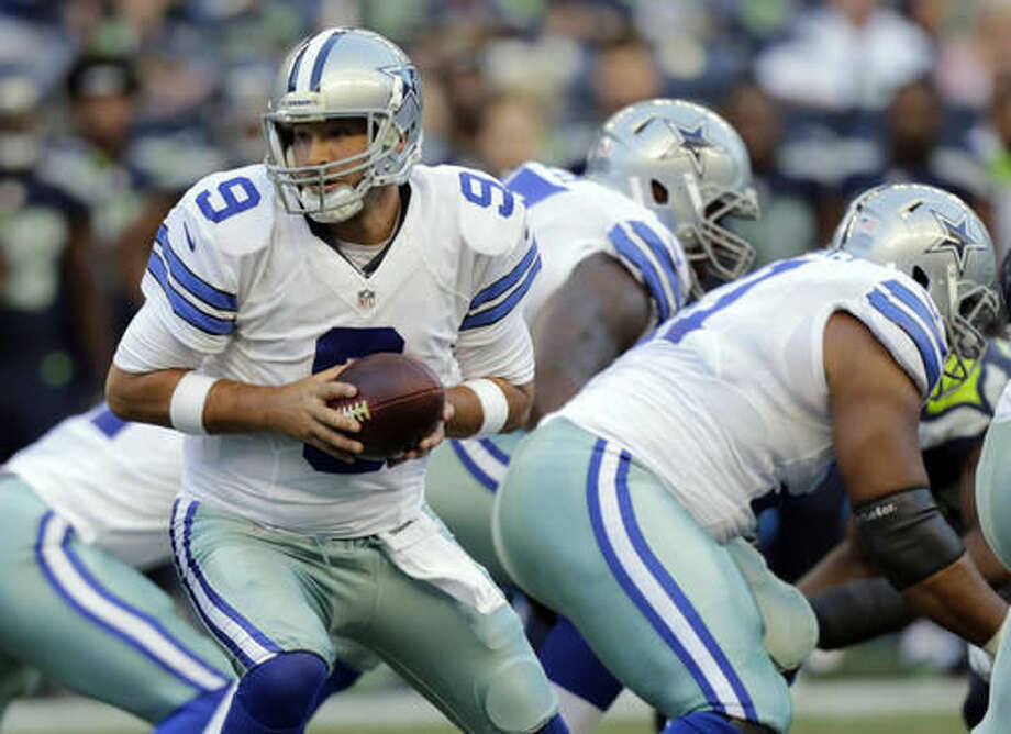 FILE - In this Aug. 25, 2016, file photo, Dallas Cowboys quarterback Tony Romo looks to hand off the ball during the first half of a preseason NFL football game against the Seattle Seahawks in Seattle. The question no longer is whether Romo can duplicate the success he had just two years ago when he led the Cowboys to 12 wins and the NFC East title. Rather, people wonder if can stay healthy to play at all. (AP Photo/Stephen Brashear, File)