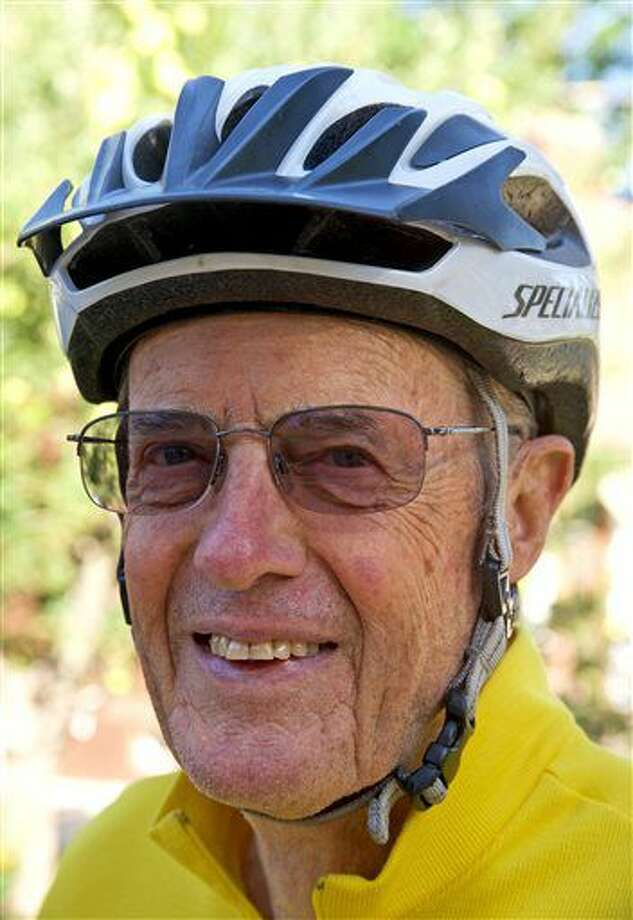 In this Sept. 2, 2016 photo, Leland Walser, 77, a retired Weber State professor of foreign languages poses in Ogden, Utah. Walser along with his teammates, ranging in ages from 66-81, has been training to compete in the LoToJa Classic, one of the premier amateur bike races in the country, which is scheduled for Saturday, Sept. 10. (Sarah Welliver/Standard-Examiner via AP)