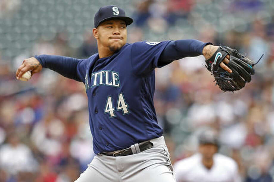 Seattle Mariners starting pitcher Taijuan Walker throws to the Minnesota Twins in the first inning of a baseball game Sunday, Sept. 25, 2016, in Minneapolis. (AP Photo/Bruce Kluckhohn)