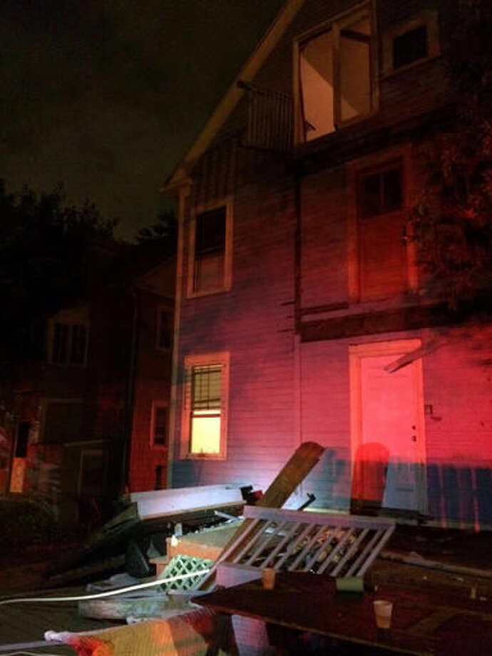 This photo provided by the Hartford Police Department shows a collapsed deck at a house near Trinity College in Hartford, Conn., Saturday, Sept. 10, 2016. Deputy Chief Brian Foley of the Hartford police posted on his Twitter feed that a third-floor deck of a house about two-tenths of a mile from the Trinity campus collapsed onto a second-floor deck, which subsequently fell onto a first-floor deck. Foley says the injured have been sent to area hospitals. (Hartford Police Department via AP)