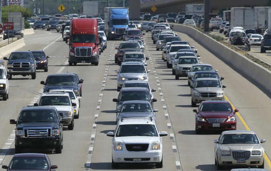 FILE - In this Friday, July 1, 2016, file photo, drivers work their way out of Dallas during rush hour. Motorists in parts of the country could pay a little more for gasoline in coming days because of the shutdown of a leaking pipeline in Alabama. Near Birmingham, Ala., work crews were trying Friday, Sept. 16, 2016, to repair the pipeline. Georgia-based Colonial Pipeline said most of the spilled gasoline has been corralled in a retention pond, and it downplayed any threat to public safety. It's not clear when the leak started. It was detected Sept. 9. (AP Photo/LM Otero, File)