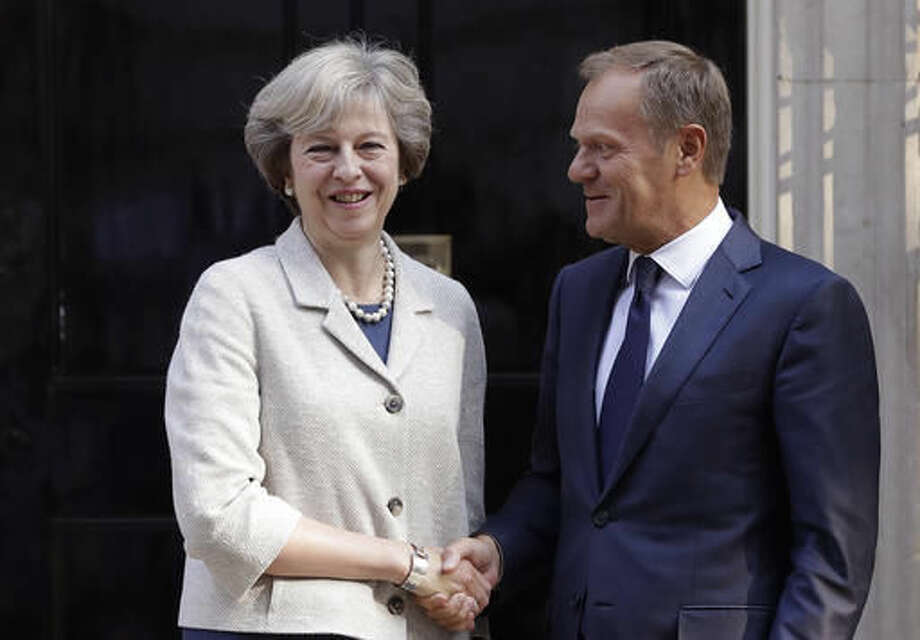 Britain's Prime Minister Theresa May, left, welcomes President of the European Council Donald Tusk to 10 Downing Street in London, Thursday, Sept. 8, 2016. They met for a bilateral meeting to discuss Britain's Exit of the European Union. (AP Photo/Kirsty Wigglesworth)