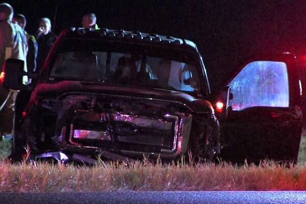 Investigators with the Bexar County Sheriff's Office say a man sleeping in a car parked along U.S. 37 on the Far South Side was killed when a truck crashed into him Sunday morning, Oct. 23, 2016.
