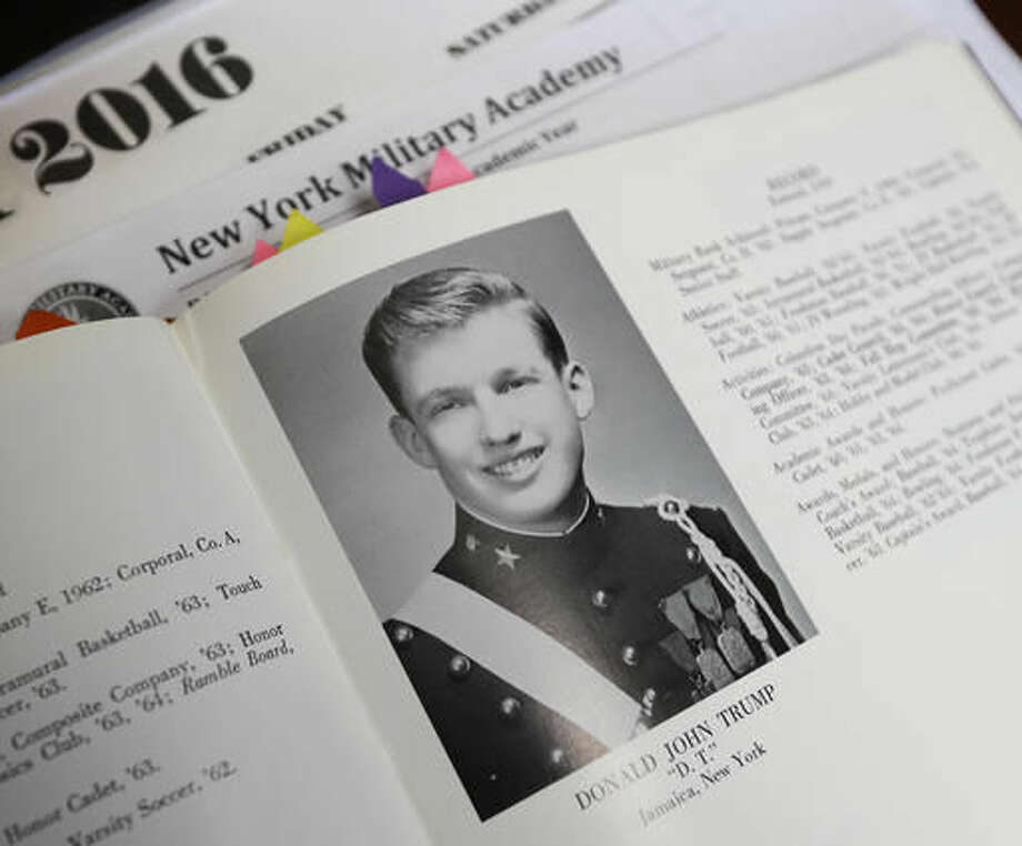 In this Thursday, Sept. 8, 2016 photo, Donald Trump is shown in the 1964 Shrapnel yearbook at the New York Military Academy in Cornwall-on-Hudson, N.Y. While Republican presidential nominee, Trump, talks tough about dealing with China, his old military prep school is building bridges to that country. The New York Military Academy began classes this fall with new Chinese backing and a former New York City high school principal originally from China in charge. (AP Photo/Mike Groll)