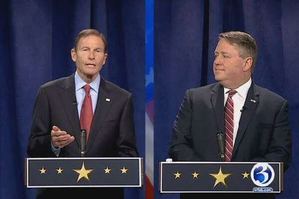 """U.S. Sen. Richard Blumenthal, D-Conn., left, and his GOP challenger, state Rep. Dan Carter, R-Bethel, face off during a televised debate on """"Face the State"""" on WFSB Channel 3 Sunday, Oct. 23, 2016."""