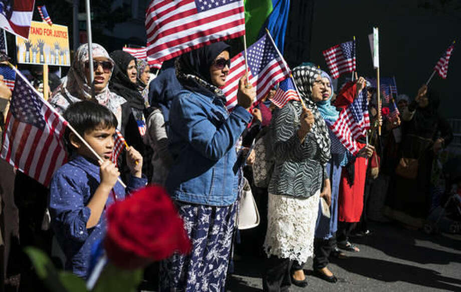 Marchers hold American flags as they participate in the Muslim Day Parade on Madison Ave., Sunday, Sept. 25 2016, in New York. (AP Photo/Craig Ruttle)