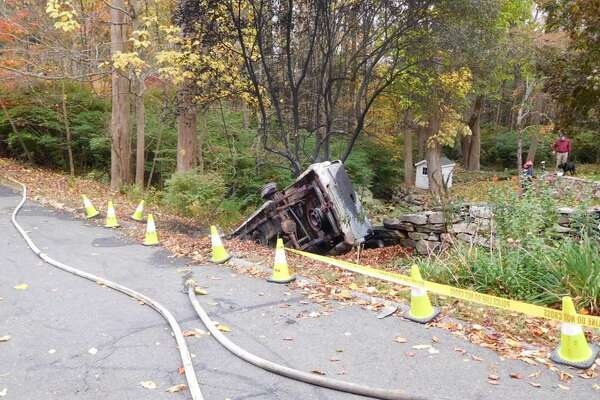 A person was killed early Saturday morning after a vehicle crashed into a ravine and burst into flames, state police said. Photo courtesy of the Oxford Fire and Rescue Facebook page.
