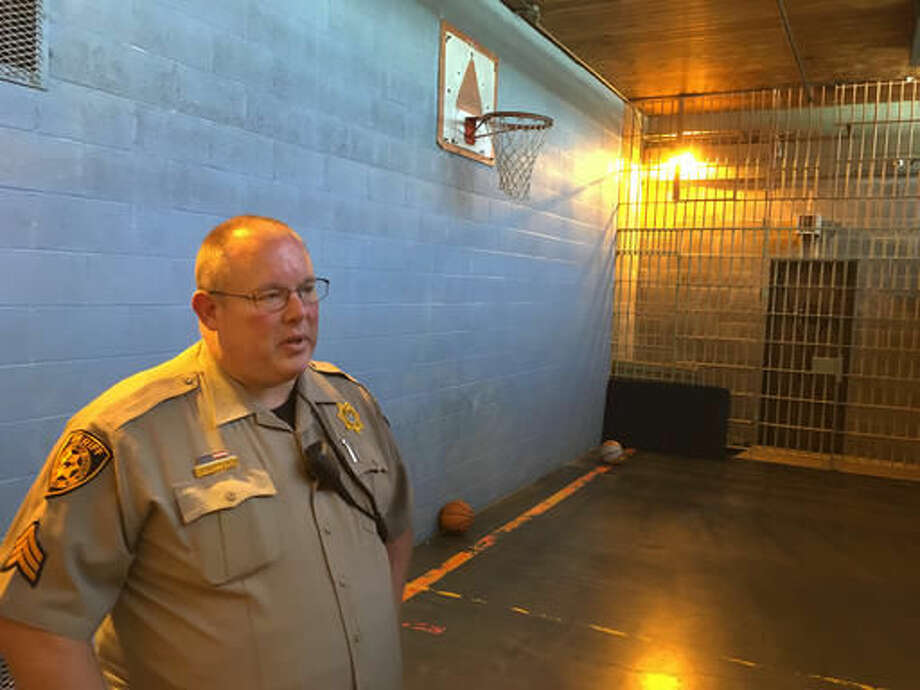 Crook County Sheriff Sgt. Jeremy Bottoms stands inside the recreation room at the Crook County Jail in Prineville, Ore., on July 1, 2016. From 1970 to 2014, the average daily number of inmates held in the roughly 3,000 county jails across the country increased four-fold, from 157,000 to 690,000, according to a report by the Vera Institute of Justice, which works with government and civil leaders to improve justice systems. (AP Photo/Andrew Selsky)