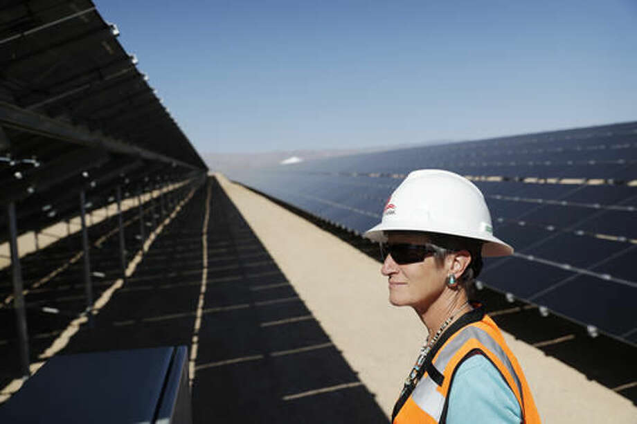 Secretary of the Interior Sally Jewell tours a solar project site, Thursday, Sept. 15, 2016, on the Moapa River Indian Reservation about 40 miles northeast of Las Vegas. Jewell was making her third stop on a tour of renewable energy sites around the country. (AP Photo/John Locher)