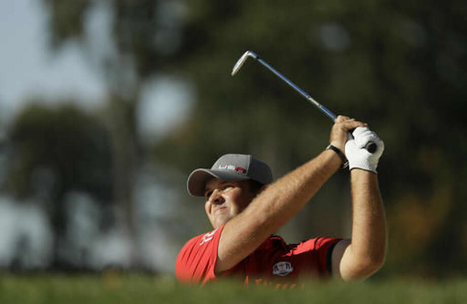 United States' Patrick Reed takes a shot on the 14th hole during a four-balls match at the Ryder Cup golf tournament Friday, Sept. 30, 2016, at Hazeltine National Golf Club in Chaska, Minn. (AP Photo/David J. Phillip)