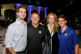 Michael Fertitta, from left, Tilman and Paige Fertitta and Blake Fertitta at the True Blue gala.  (For the Chronicle/Gary Fountain, October 22, 2016)