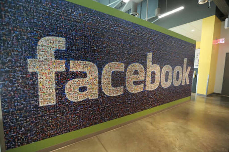 FILE - This Nov. 14, 2014, file photo, shows a board with the Facebook logo inside the new Facebook data centers in Altoona, Iowa. Facebook has chosen a village on the edge of New Mexico's largest metropolitan area as the location for its new data center, an announcement that spread quickly Wednesday, Sept. 14, 2016, as elected officials celebrated a hard-sought win that could have ripple effects for the state's struggling economy. News of the social media giant's decision to build in Los Lunas, just south of Albuquerque, comes after a roller-coaster contest between New Mexico and Utah to attract the facility. (Charlie Litchfield/The Des Moines Register via AP, File)