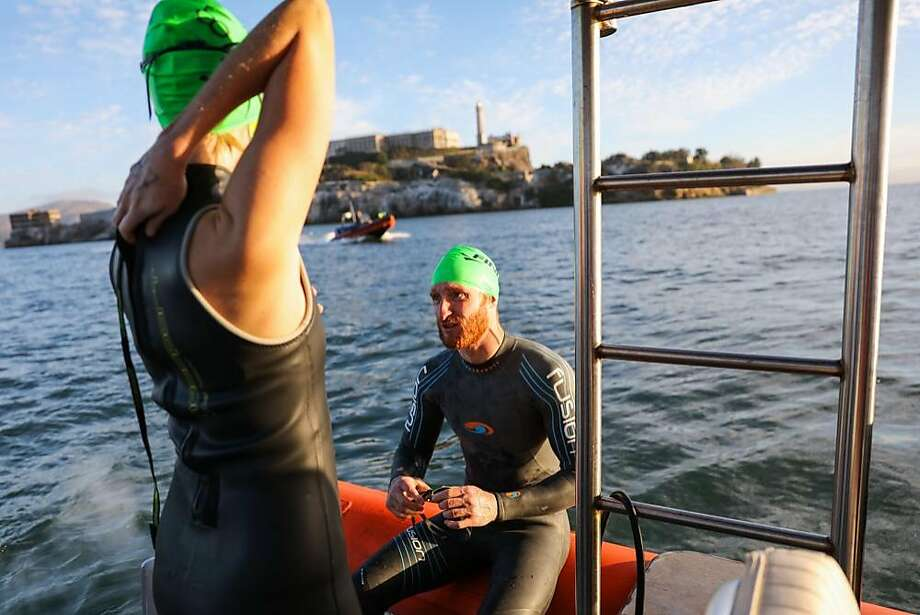 Swimmer Brad Snyder (center), who is visually impaired, chats with his guide Jill Dahle (left), before jumping in the water, at the fifth annual Alcatraz Swim for Sight race, in San Francisco, California, on Sunday, Oct. 23, 2016. Photo: Gabrielle Lurie, The Chronicle