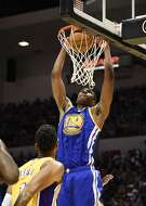 Golden State Warriors forward Kevon Looney (5) dungks plays an NBA preseason basketball game against the Los Angeles Lakers Wednesday, Oct. 19, 2016, in San Diego. (AP Photo/Denis Poroy)